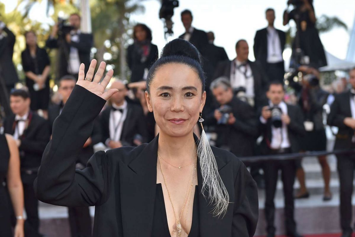 Japanese director and President of the Cinefondation and Short Films Jury Naomi Kawase arriving on May 19, 2016, for the screening of the film Graduation (Bacalaureat) at the 69th Cannes Film Festival.