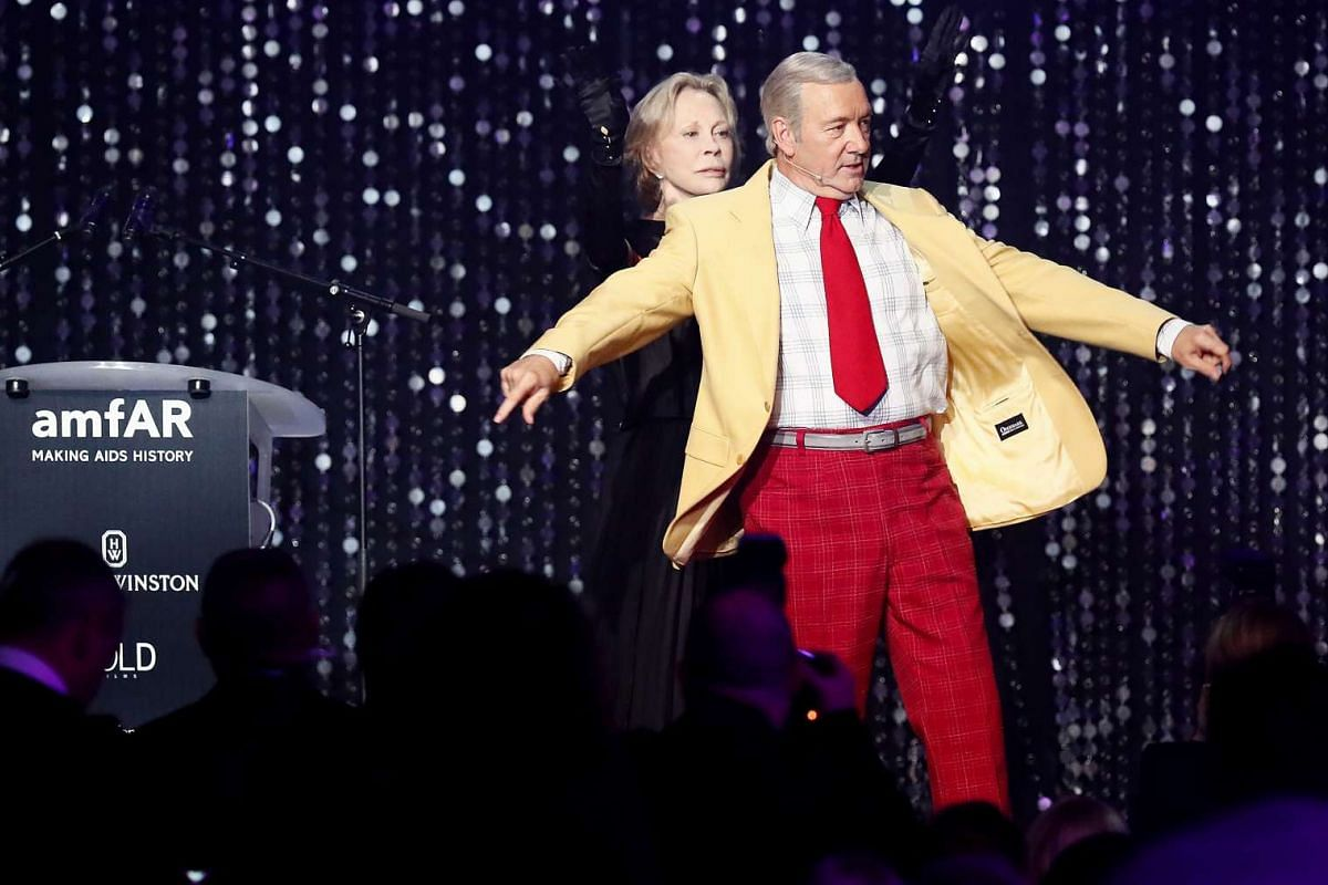 US actress Faye Dunaway (left) and US actor Kevin Spacey (right) performing during the auction dinner of the amfAR's Cinema Against Aids 2016 gala.