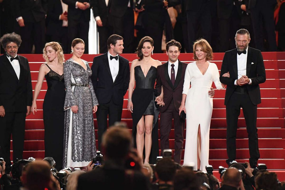 (From right) French actor Vincent Cassel, French actress Nathalie Baye, Canadian director Xavier Dolan, French actress Marion Cotillard, French actor Gaspard Ulliel, French actress Lea Seydoux and Canadian producer Nancy Grant leave on May 19, 2016,