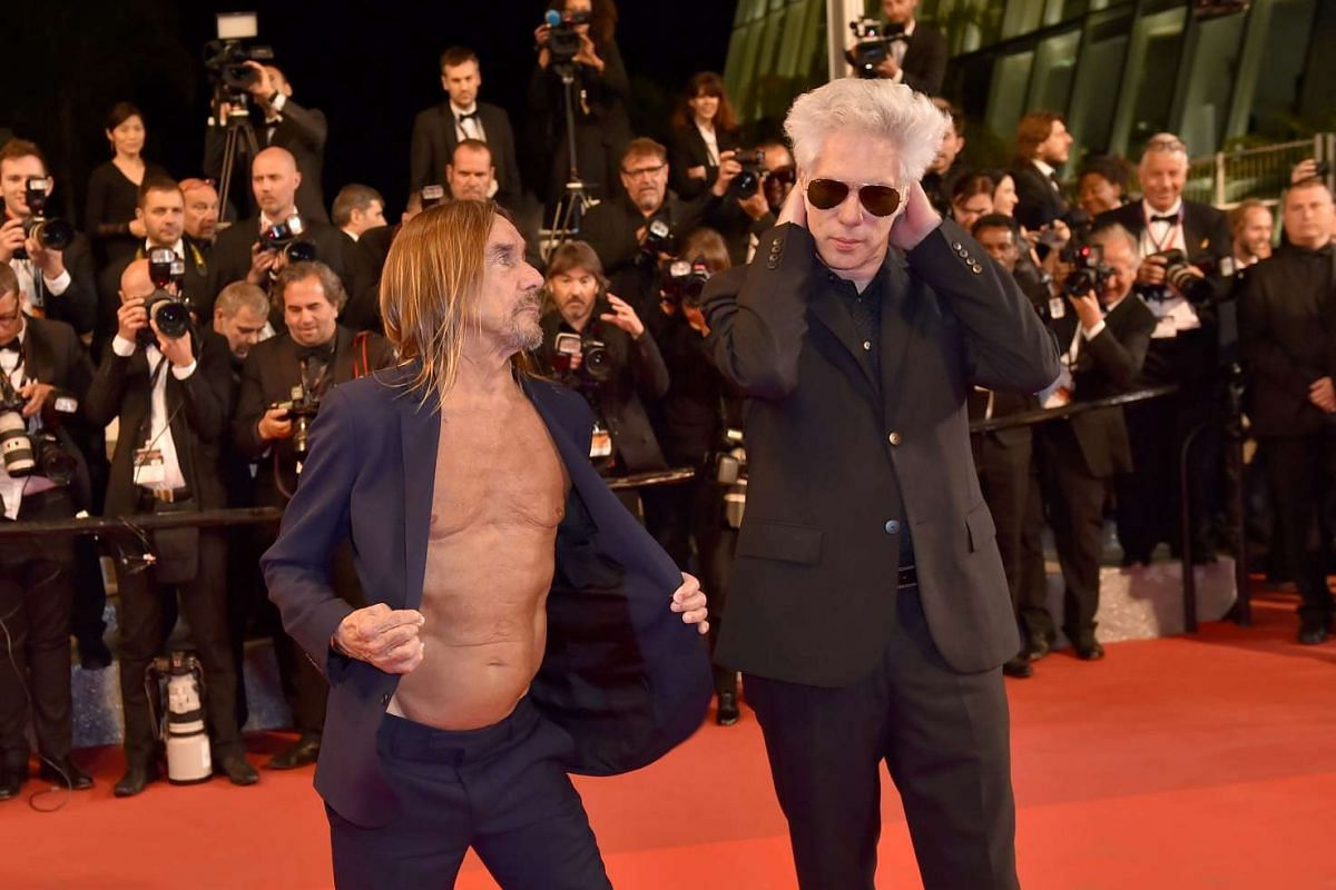 US singer Iggy Pop (left) and US director Jim Jarmusch posing as they arrive on May 19, 2016 for the screening of the film Gimme Danger at the 69th Cannes Film Festival in Cannes, southern France.