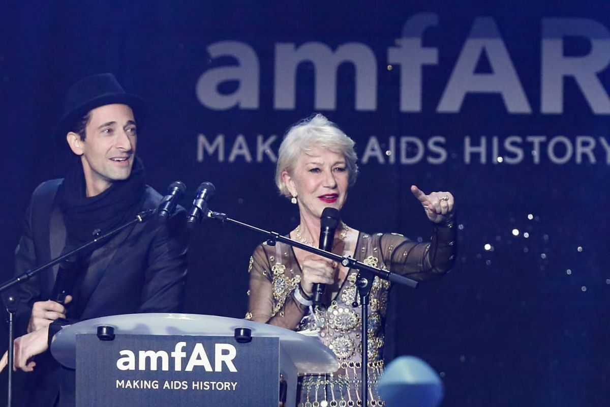 US actor Adrien Brody (left) and British actress Helen Mirren attending the auction dinner of the amfAR's Cinema Against Aids 2016 gala.