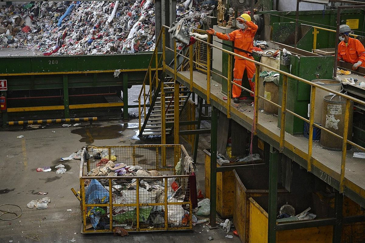 Bags of unsorted rubbish are placed in a machine called the bag splitter, which rips the bags open and drops the items within onto moving conveyor belts. Conveyor belts take the waste to staff at the primary picking station, where they pick out large
