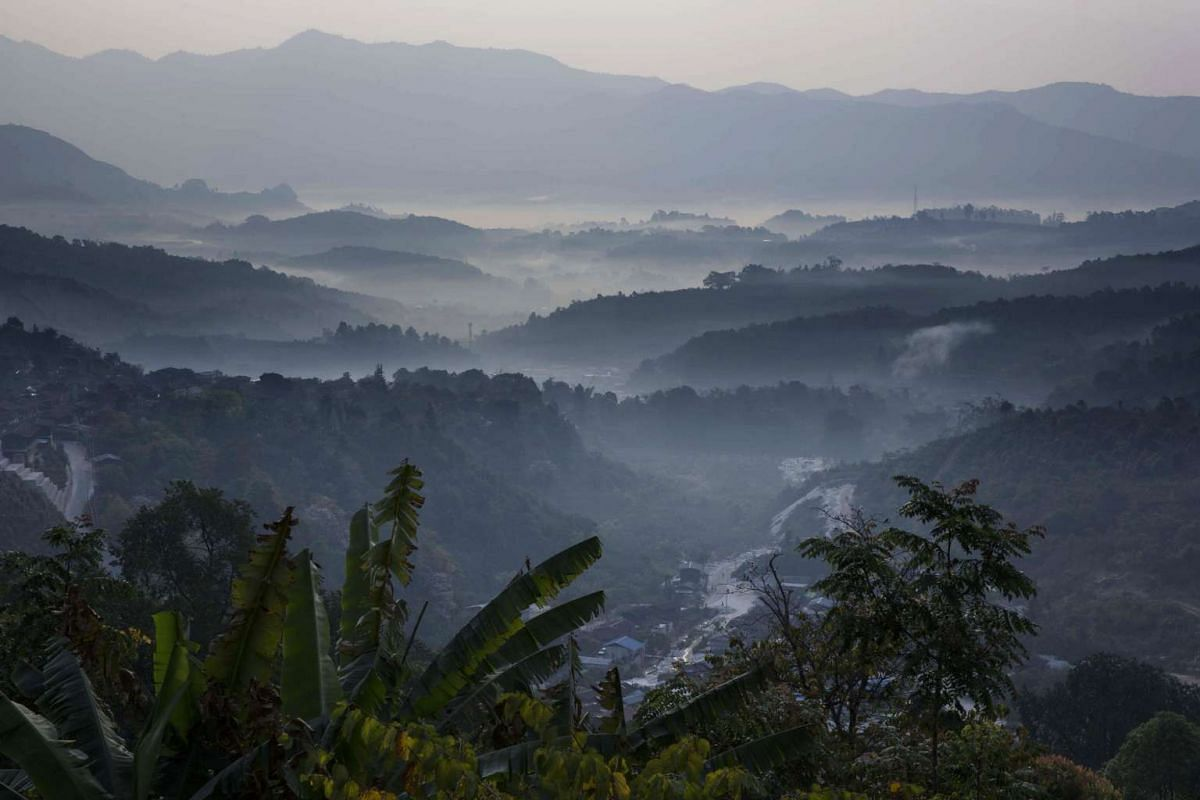 Mountains stand shrouded in mist in Mogok, Myanmar, on March 14, 2016.
