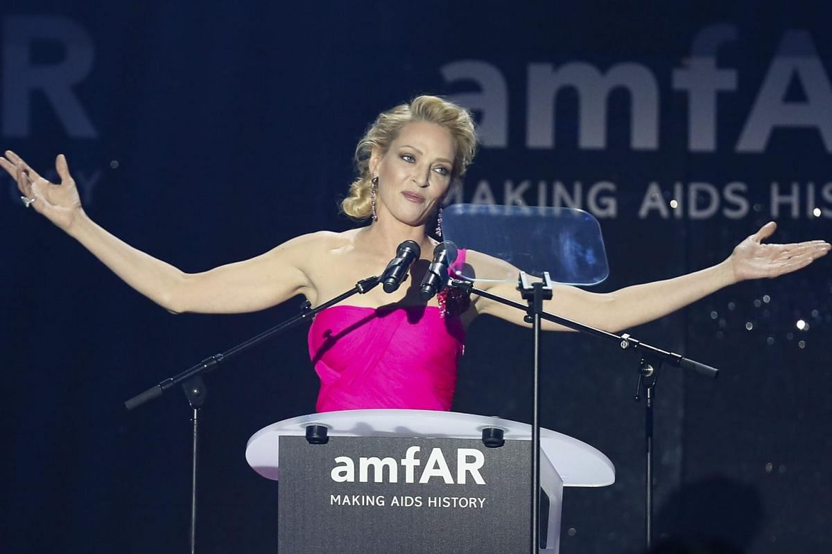 US actress Uma Thurman gesturing on stage during the auction dinner of the amfAR's Cinema Against Aids 2016 gala.