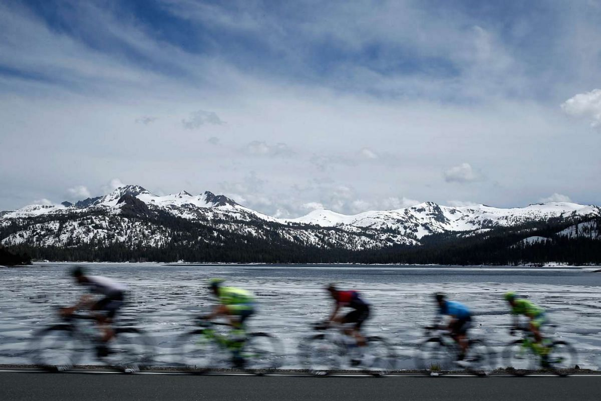The peloton rides by Caples Lake during Stage 5 of the Tour of California from Lodi to South Lake Tahoe in Kirkwood, California, on May 19, 2016.