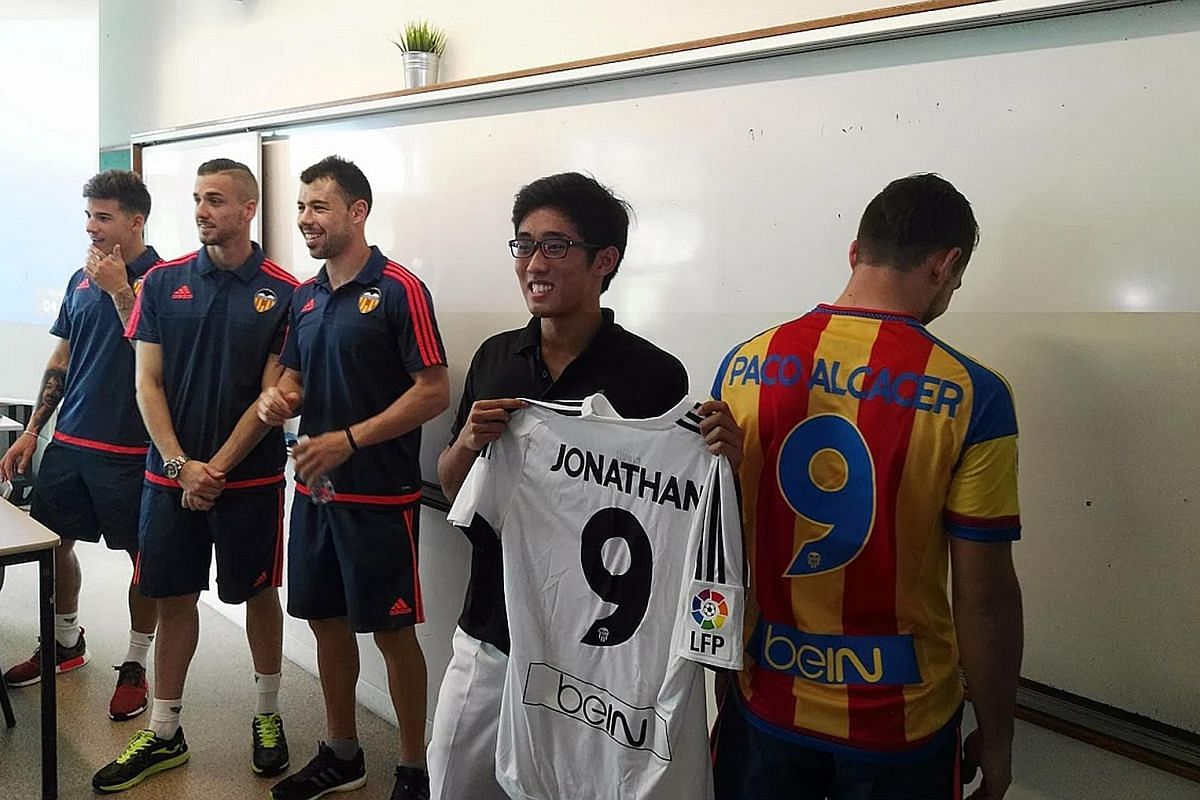 Raffles Institution student Jonathan Chua showing a football jersey presented to him by visiting players from Spanish Primera Liga club Valencia yesterday. The jersey was later autographed by the players. Jonathan made headlines last month after turn