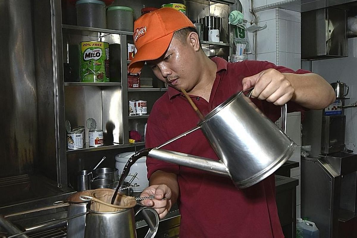 Kopi being brewed the traditional way at Killiney Kopitiam, which is participating in the Singapore Coffee Festival.