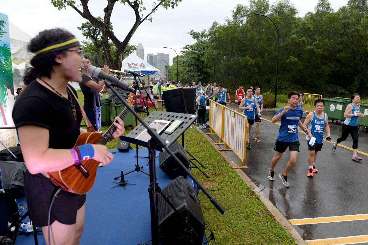 Participants running past performers onstage at The Straits Times Run 2016, on May 22, 2016.