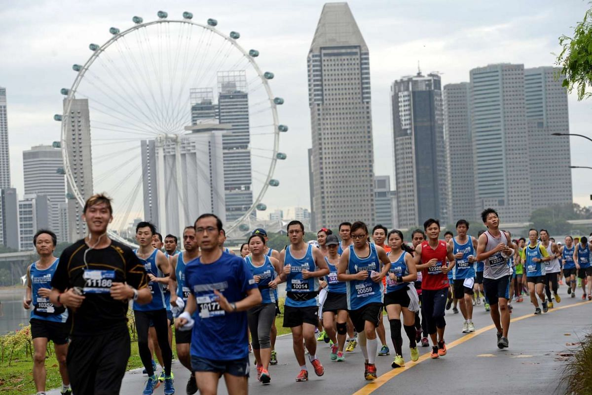 Participants running with the Singapore Flyer in the background in The Straits Times Run 2016, on May 22, 2016.