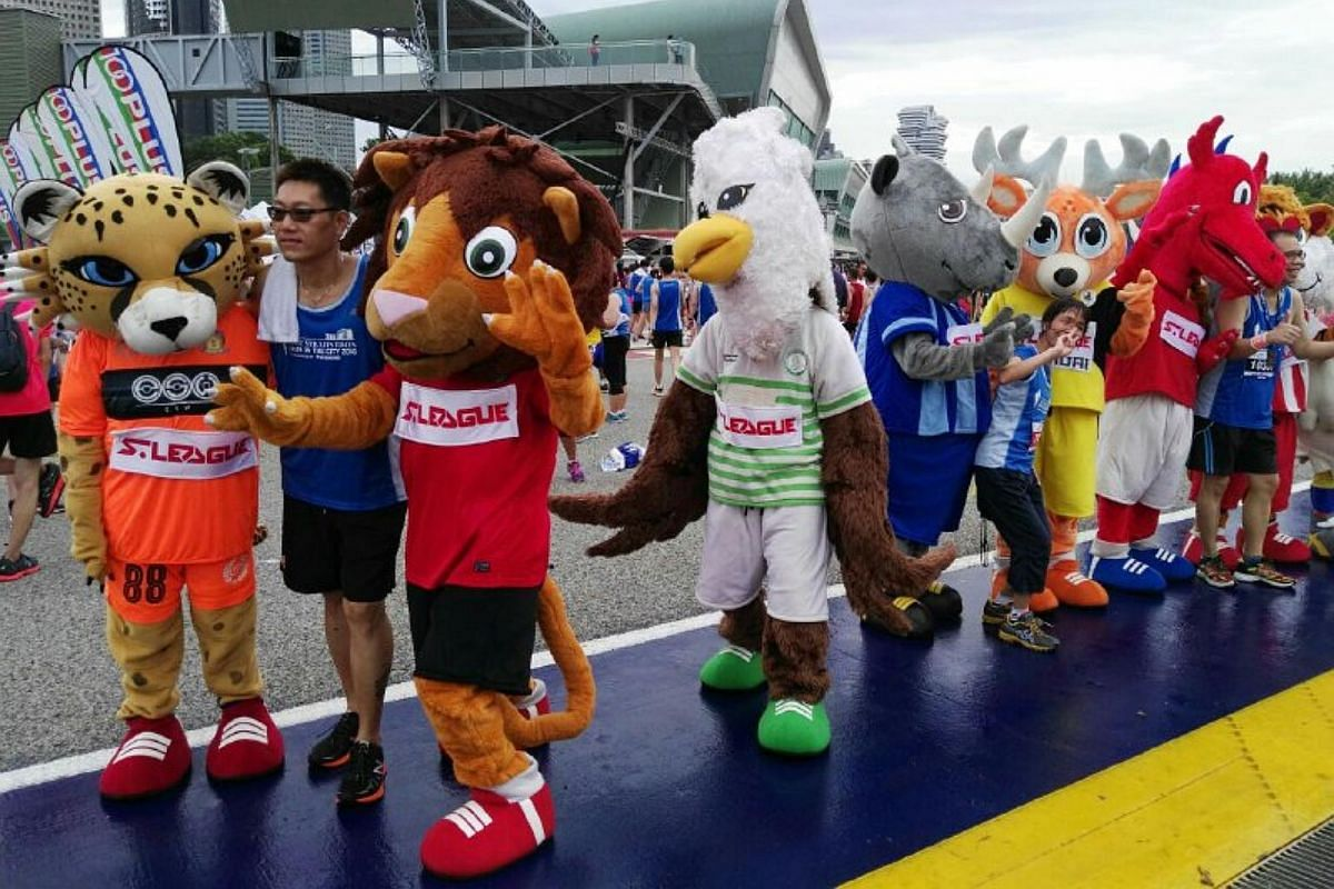 Participants who completed their races take pictures with S League club mascots.