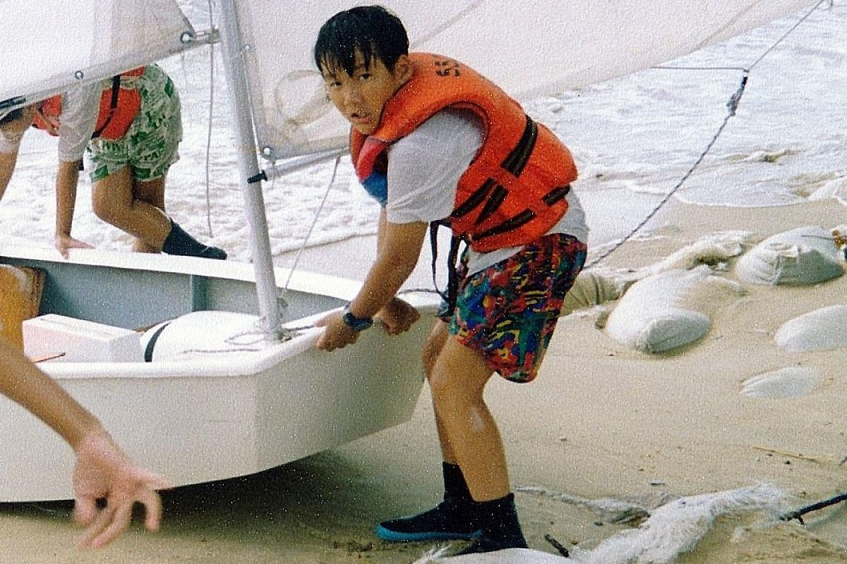 My life so far: Mr Edward Chia when he was aged seven and at a school sailing class when he was nine (above).