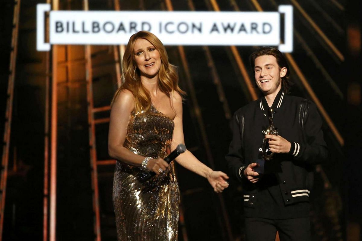 Billboard Icon Award recipient Celine Dion reacts as her son Rene Charles presents the award to her at the 2016 Billboard Awards in Las Vegas.