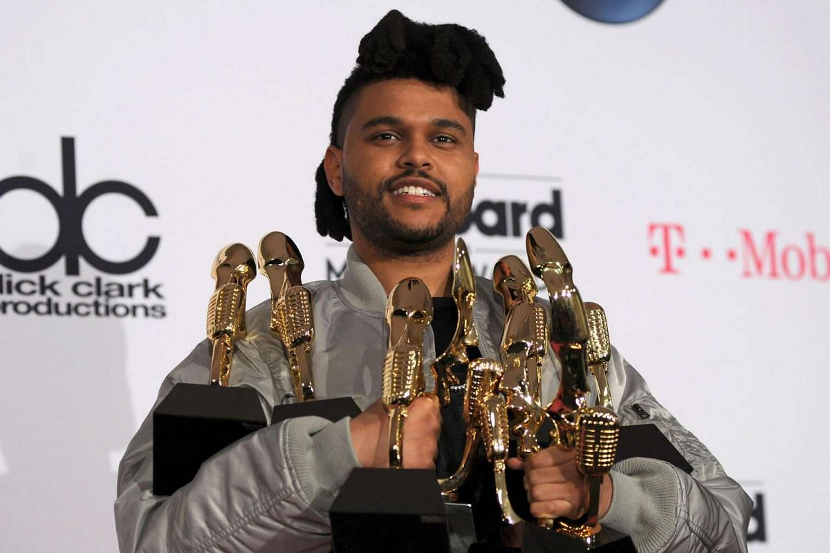 The Weeknd, winner of the Top Songs Sales Artist award, Top Radio Song award for Can't Feel My Face, Top Hot 100 Artist award, Top Radio Songs Artist award, Top Streaming Song (Audio) award for The Hills, Top R&B Artist award, and Top R&B Song award