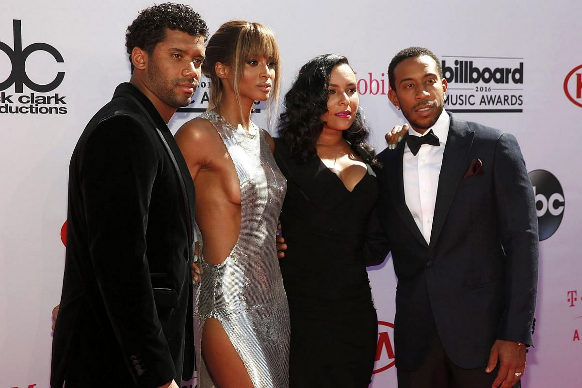(From left) NFL football player Russell Wilson, singer Ciara, model Eudoxie Mbouguiengue and show co-host Ludacris arrive at the 2016 Billboard Awards in Las Vegas.
