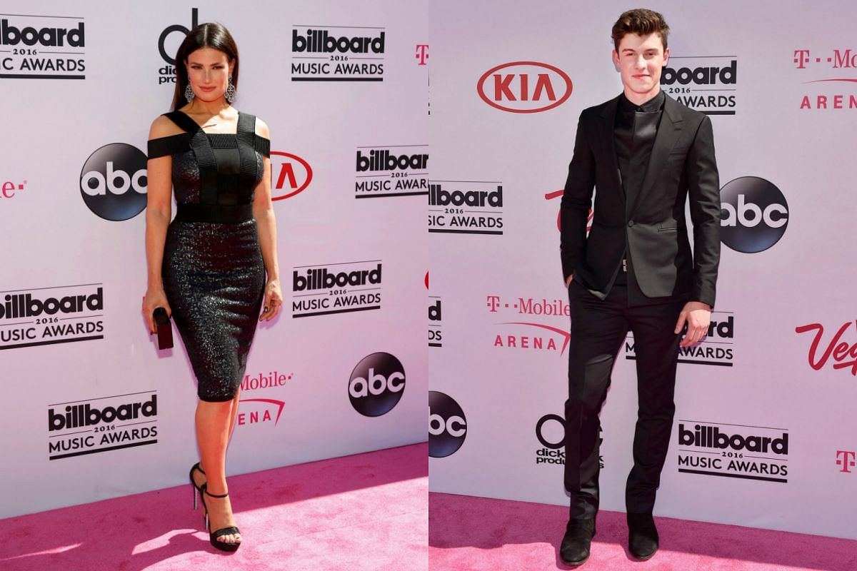Singers Idina Menzel (left) and Shawn Mendes arrive at the 2016 Billboard Awards in Las Vegas.
