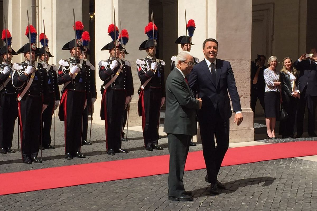 Day 1: President Tony Tan Keng Yam (left) and Italian Prime Minister Matteo Renzi share a handshake at Mr Renzi's official residence, the Palazzo Chigi.