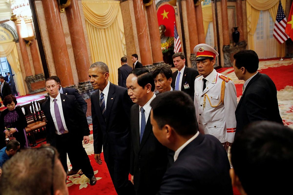 U.S. President Barack Obama and Vietnam's President Tran Dai Quang walking after an arrival ceremony at the presidential palace in Hanoi, Vietnam on May 23, 2016.