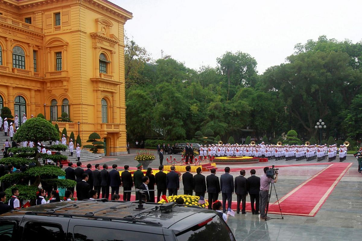 US President Barack Obama and his Vietnamese counterpart Tran Dai Quang attending a welcoming ceremony at the Presidential Palace in Hanoi, Vietnam, on May 23, 2016.