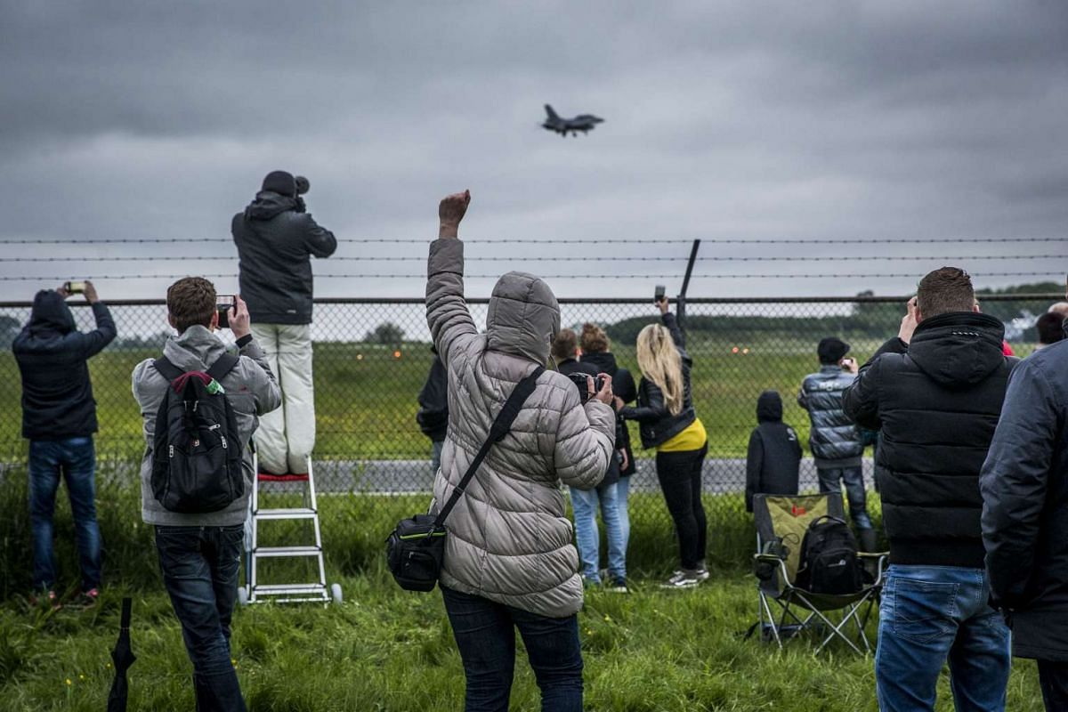 People watch the first two American F-35C Lightning II fighter jets as they land in Leeuwarden, The Netherlands, on May 23, 2016. PHOTO: AFP/ANP