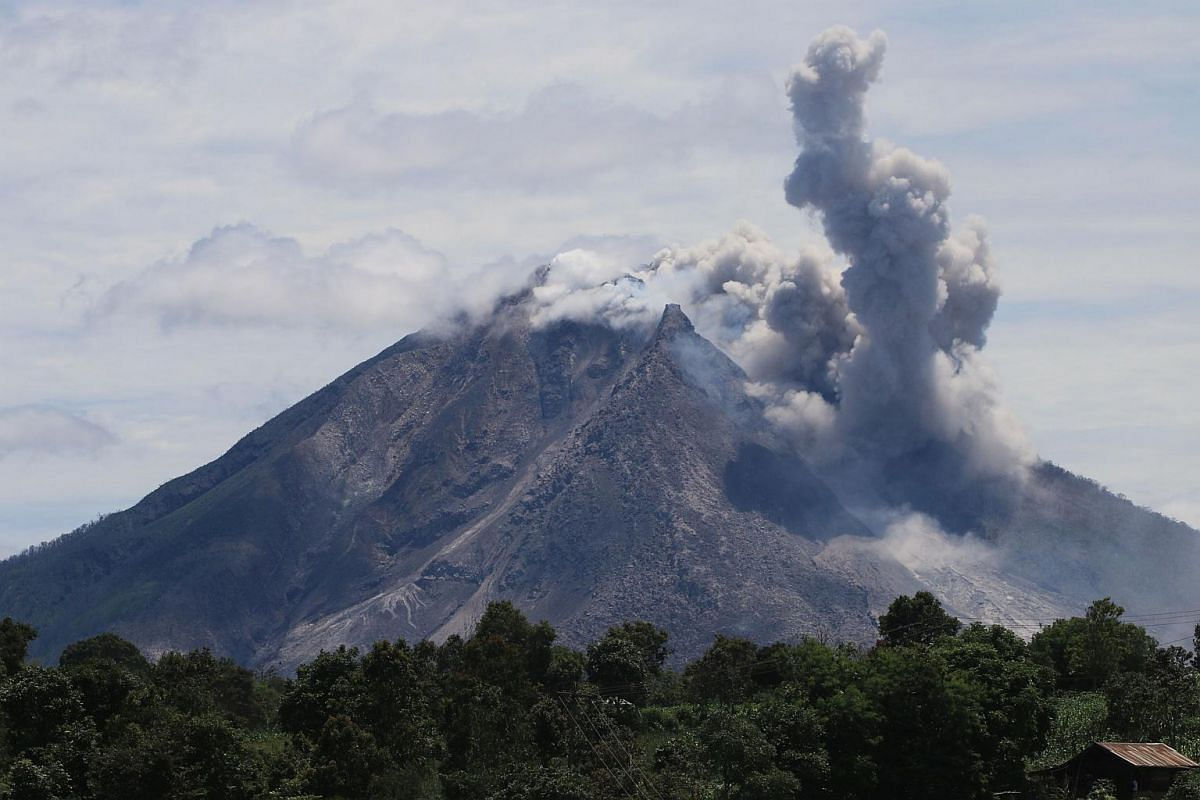The Sinabung volcano spews hot clouds of ash, as seen from the Simpang Empat subdistrict in Karo, North Sumatra on May 22, 2016.
