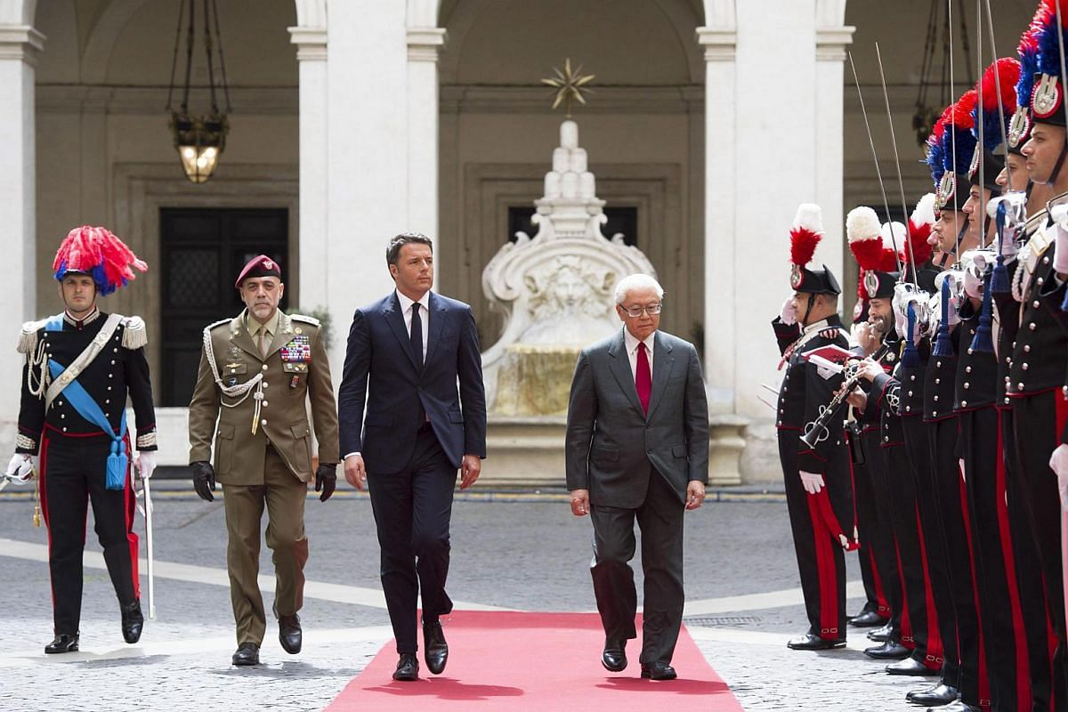 Day 1: President Tony Tan (right) and Italian Prime Minister Matteo Renzi inspecting the guard of honour at the Palazzo del Quirinale.
