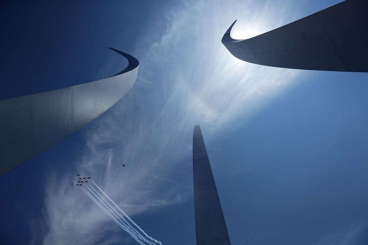 Canadian Armed Forces Snowbirds air demonstration aircrafts fly in formation over the Air Force Memorial May 24, 2016 in Arlington, Virginia. PHOTO: GETTY IMAGES/AFP