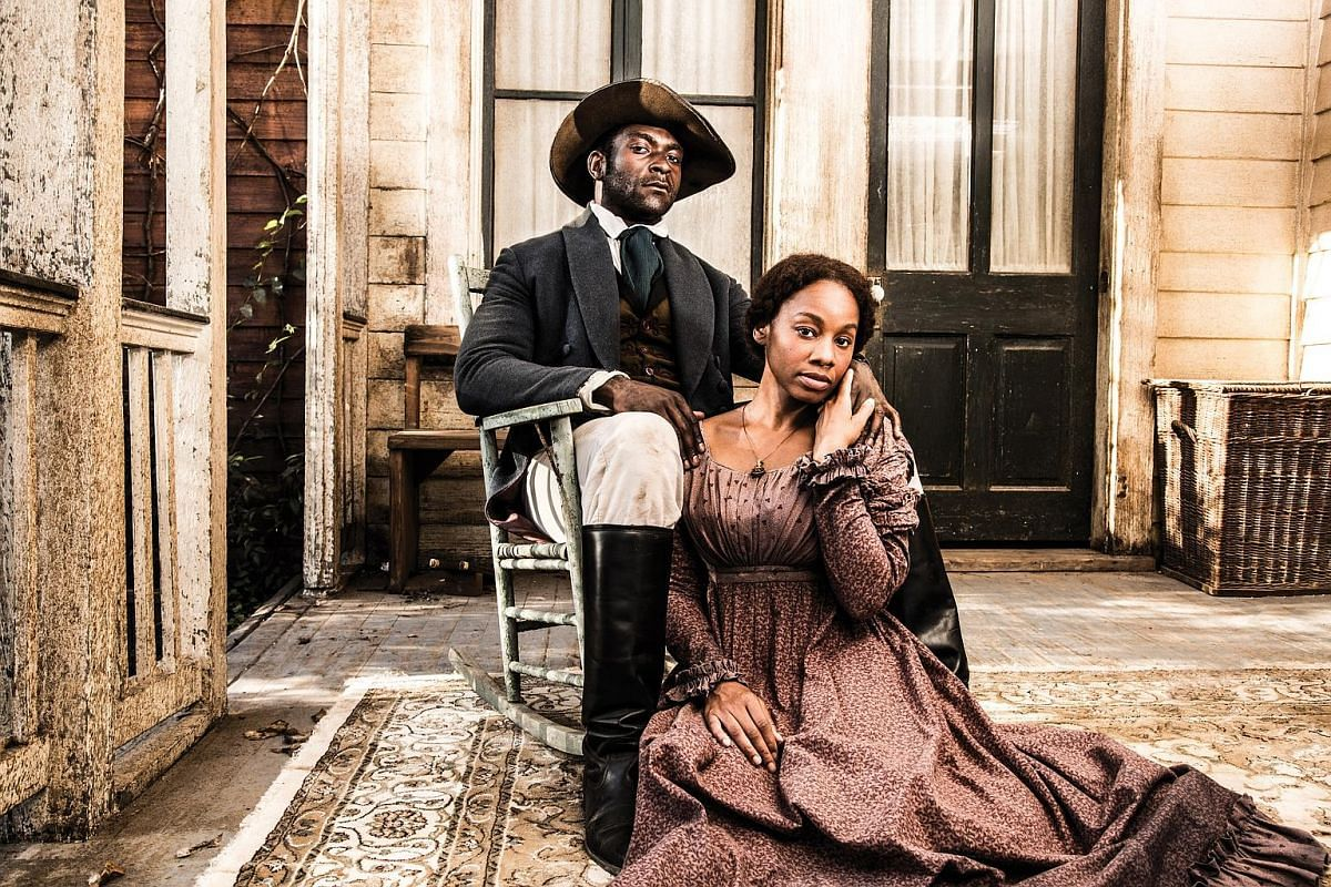 Roots, which tells the story of an African slave sold to America and his descendants, stars Anika Noni Rose and Michael James Shaw (both above) as slaves and Jonathan Rhys Meyers (left, centre) as a slave owner.