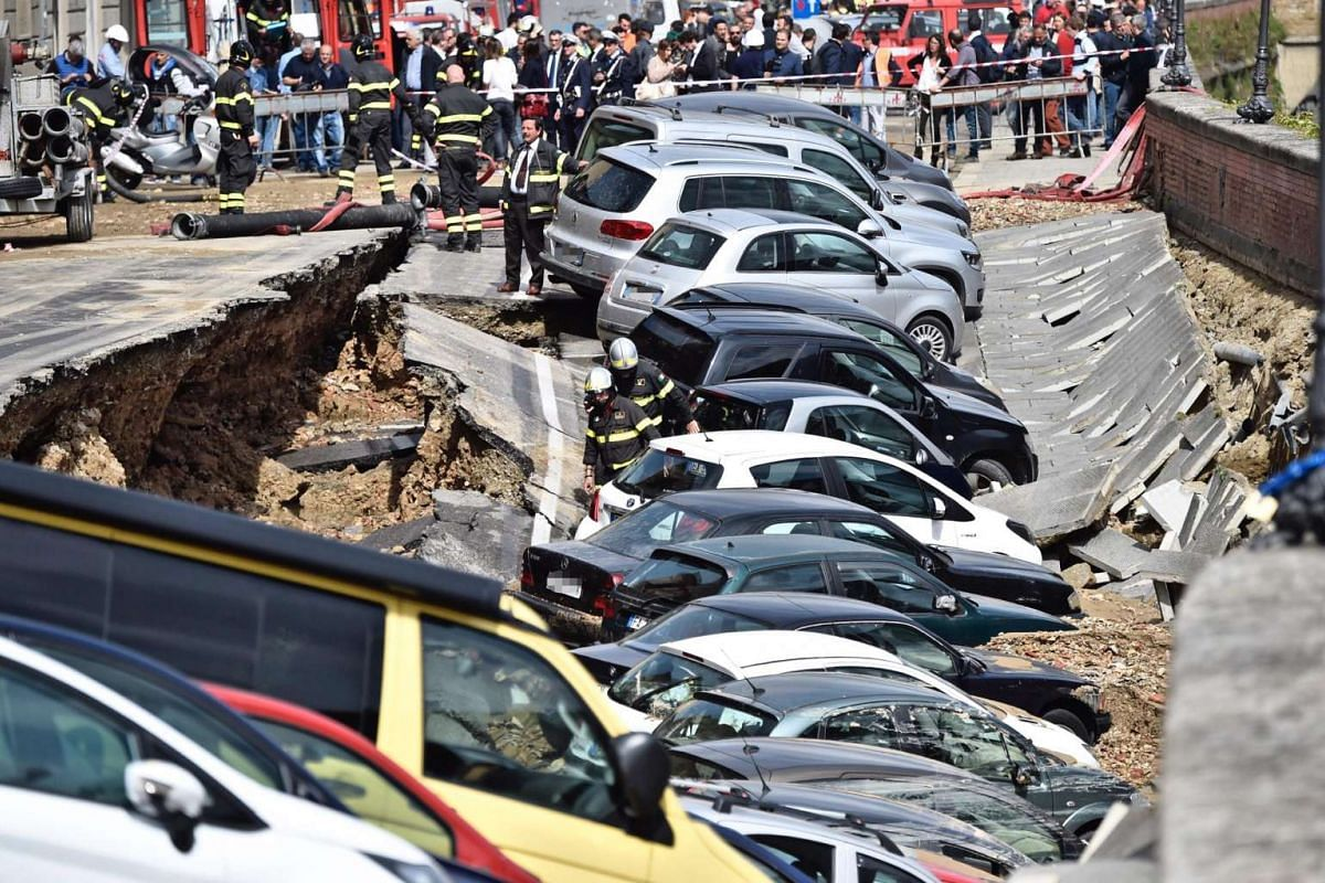 A chasm measuring about 200m long and 7m wide opened up near Ponte Vecchio in central Florence on May 25, 2016, sending vehicles tumbling into the hole. PHOTO: EPA
