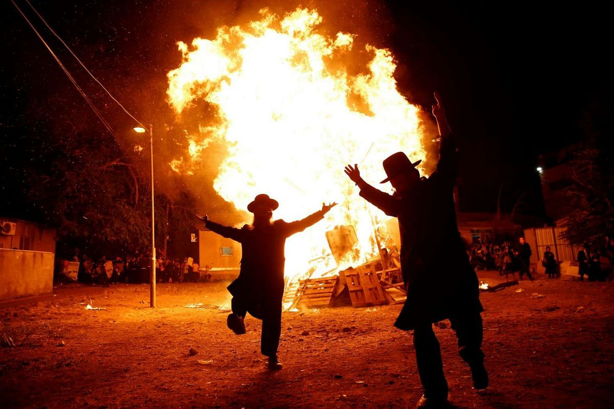 Ultra-Orthodox Jews dance next to a bonfire during celebrations for the Jewish holiday of Lag Ba-Omer in Jerusalem's Mea Shearim neighbourhood May 25, 2016. PHOTO: REUTERS