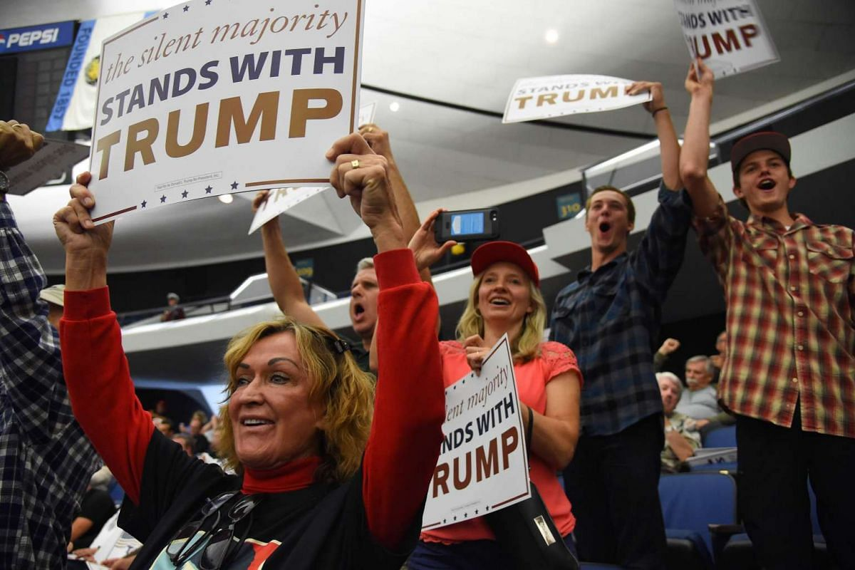 Supporters of US Republican presidential candidate Donald Trump attend a campaign rally, on May 25, 2016 in Anaheim, California.