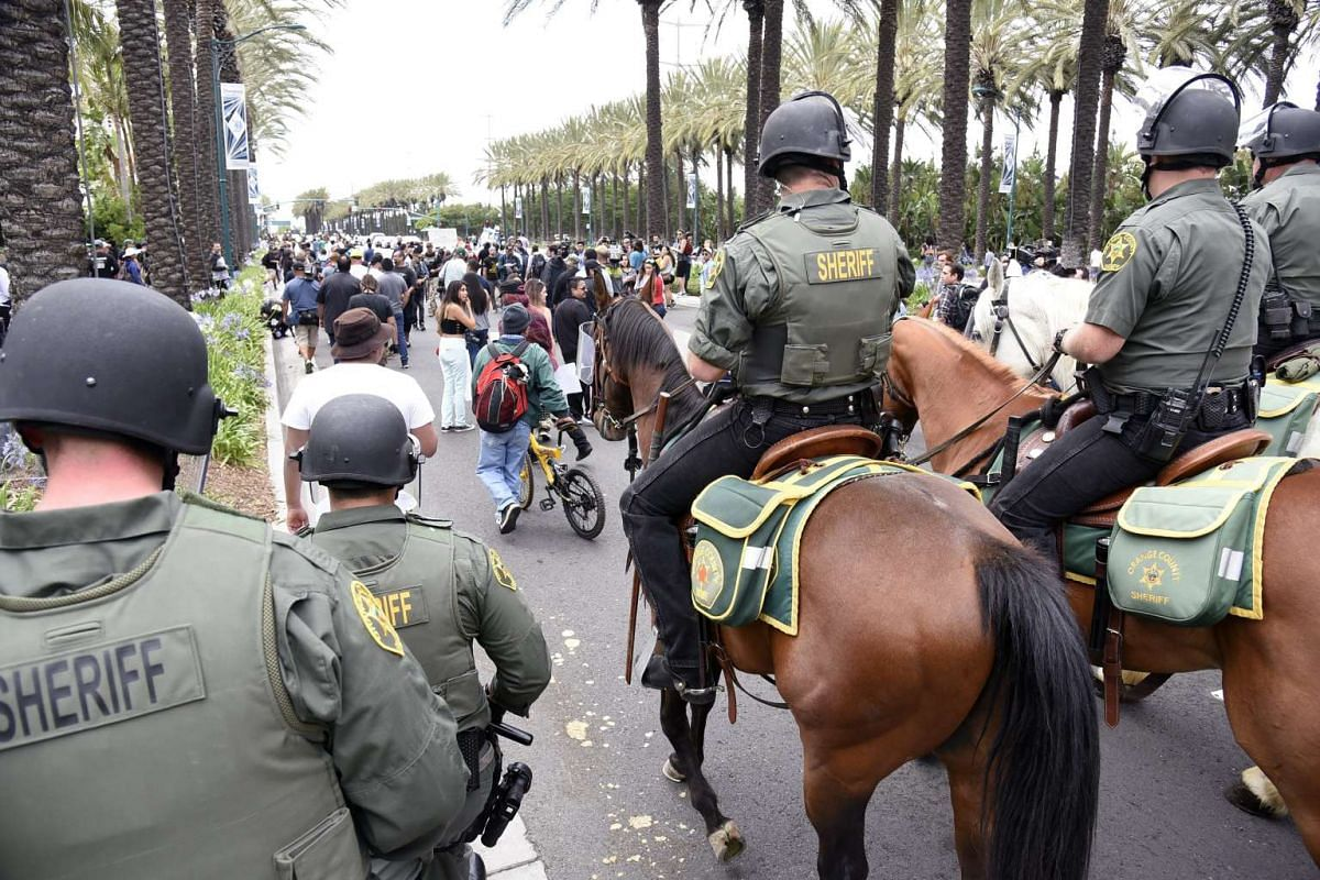 Law enforcement officers force the crowd away after US Republican presidential candidate Donald Trump's rally at the Anaheim Convention Center in Anaheim, California, USA, on May 25,  2016.