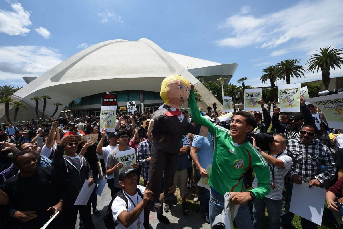 Protestors gather outside the Anaheim Convention Center with an effigy of Donald Trump prior to a rally for the US Republican presidential candidate on May 25, 2016 in Anaheim, California. PHOTO