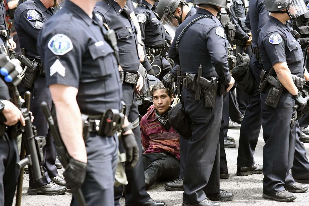 A person is arrested by law enforcement officers after failing to leave the area after US Republican presidential candidate Donald Trump's rally at the Anaheim Convention Center in Anaheim, California, USA, on May 25, 2016.