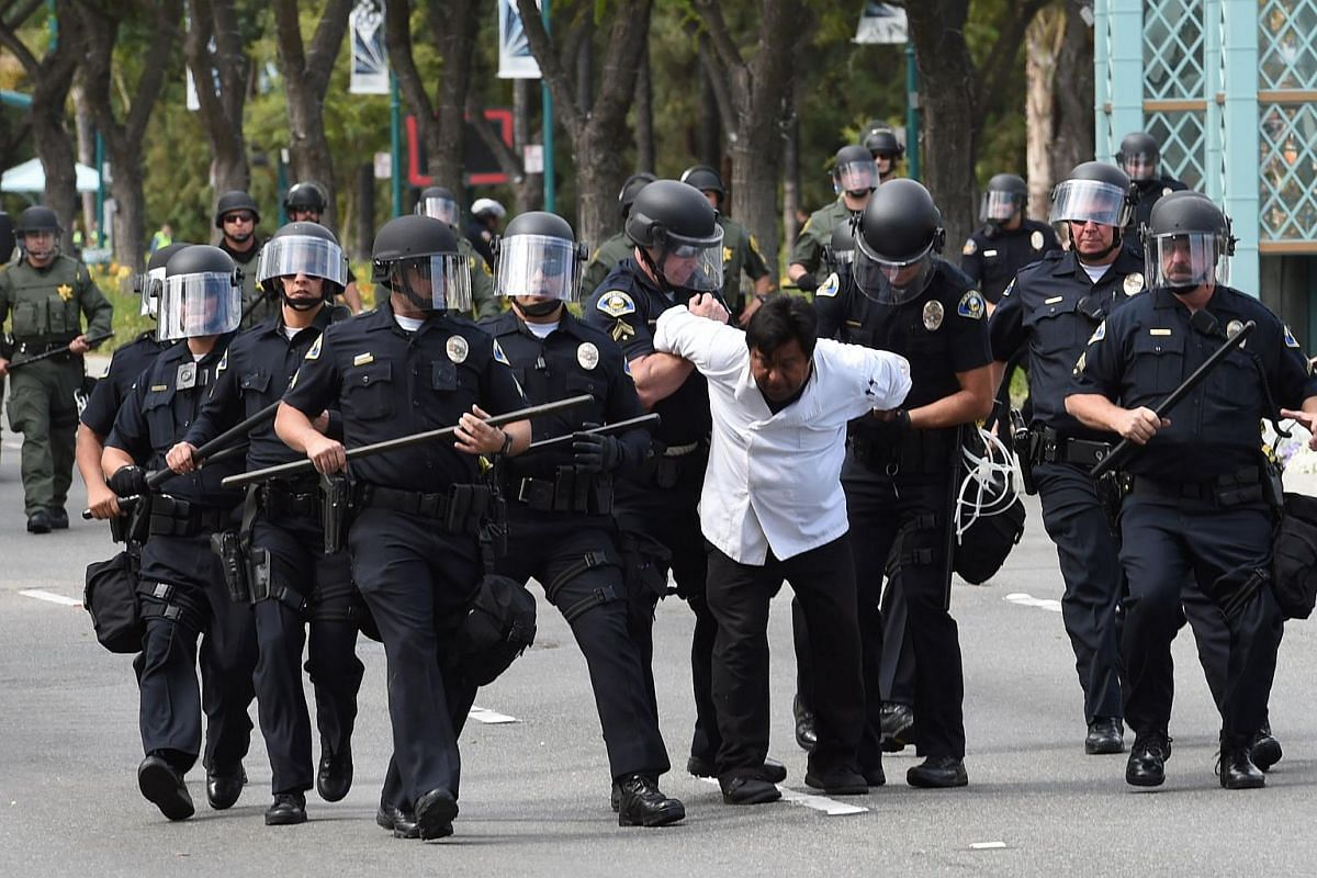 Police arrest a protestor during an anti-Trump demonstration outside the Anaheim Convention Center prior to a rally for US Republican presidential candidate Donald Trump on May 25, 2016 in Anaheim, California.