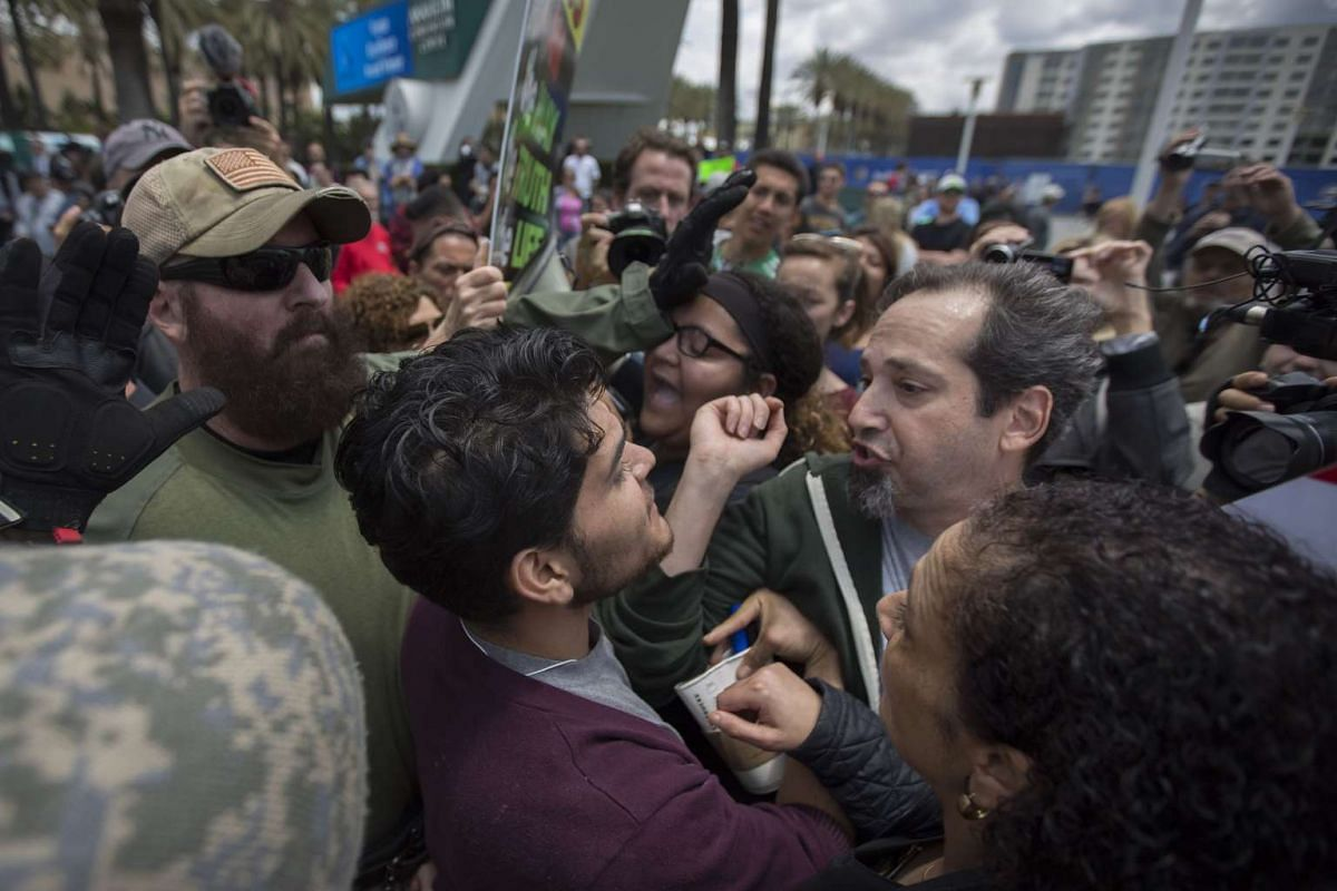 Anti-Trump protesters and Trump supporters clash outside a campaign rally by US Republican presidential candidate Donald Trump at the Anaheim Convention Center on May 25, 2016 in Anaheim, California.