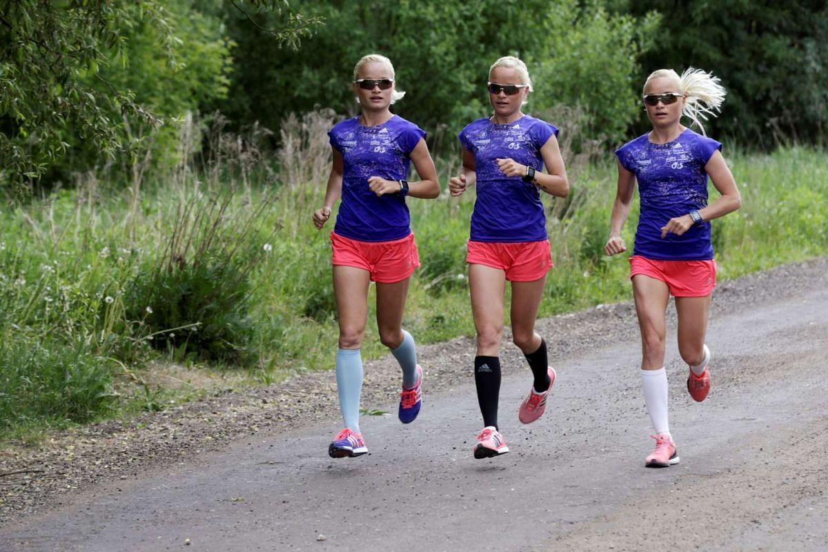 Estonia's olympic team female marathon runners triplets (L-R) Leila, Liina and Lily Luik take part in a training session in Tartu, Estonia, May 26, 2016. PHOTO: REUTERS