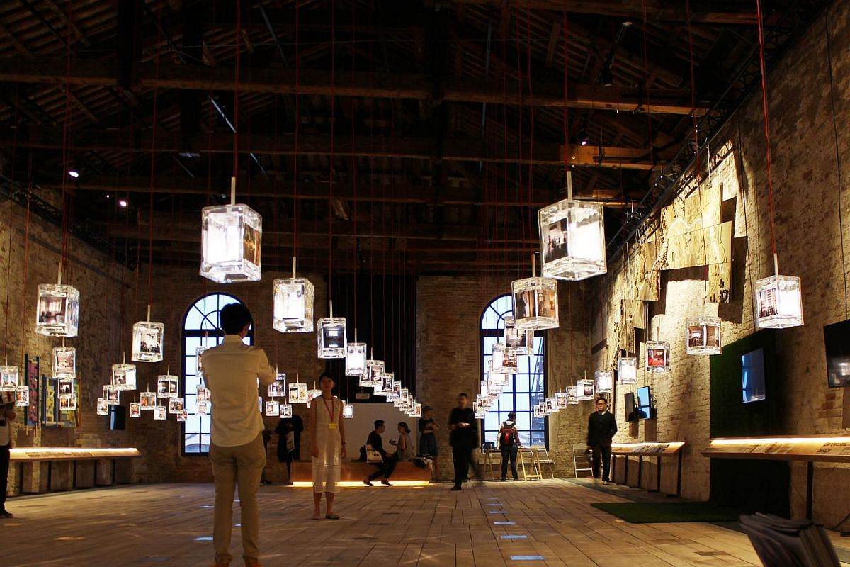 The Singapore Pavilion at the 15th International Architecture Exhibition. The lanterns show photos and models of people's homes.