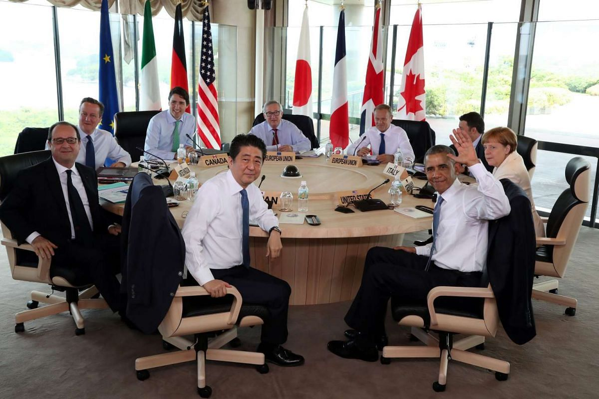 US President Barack Obama (centre, right) and Japanese Prime Minister Shinzo Abe (centre, left) attending a working session with (clockwise from left) French President Francois Hollande, British Prime Minister David Cameron, Canadian Prime Minister J