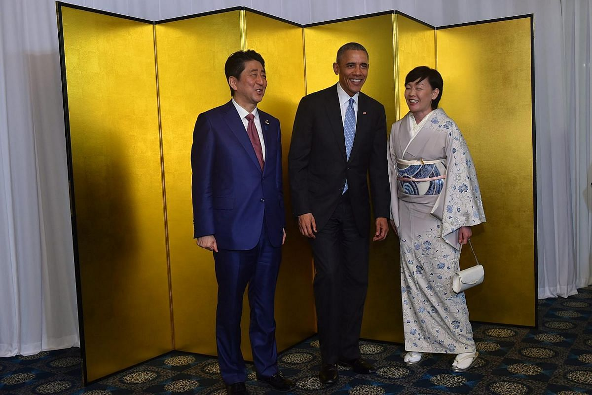 Japanese Prime Minister Shinzo Abe (left) and his wife Akie welcoming US President Barack Obama (centre) before a cocktail reception at the Shima Kanko Hotel in Shima, Mie prefecture, Japan, on May 26.
