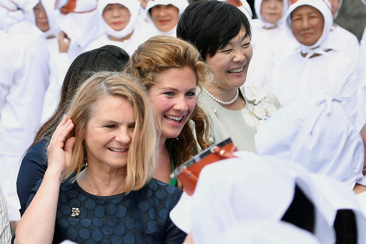 Partners of the G-7 summit participants Malgorzata Tusk (left), wife of European Council President Donald Tusk, Sophie Gregoire-Trudeau (centre), wife of Canada's Prime Minister Justin Trudeau, and Akie Abe, wife of Japanese Prime Minister Shinzo Abe