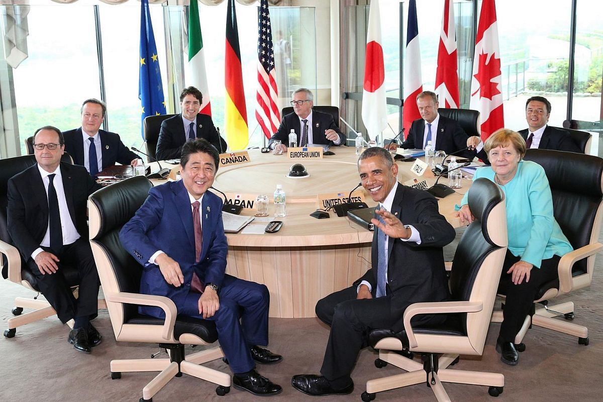 G-7 leaders, including (front, from left) French President Francois Hollande, Japanese Prime Minister Shinzo Abe, US President Barack Obama and German Chancellor Angela Merkel, posing for photographers prior to their meeting in the city of Shima on M