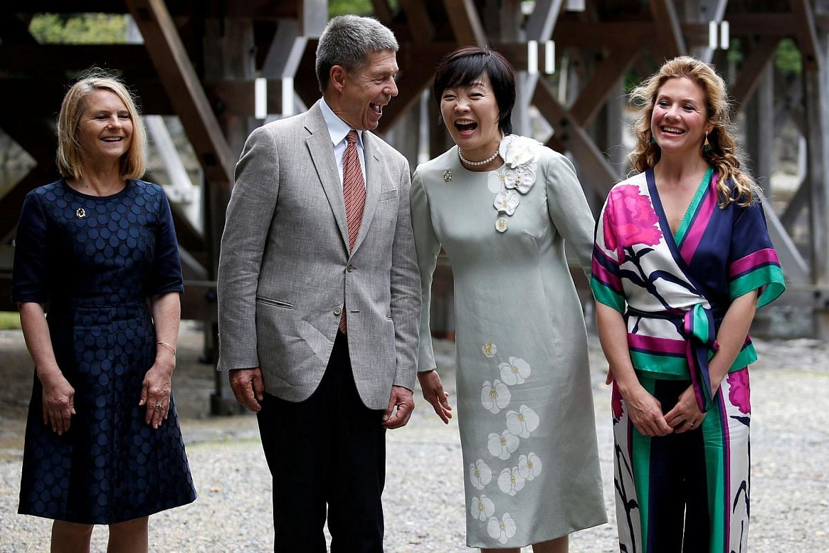 Partners of the G-7 summit participants Malgorzata Tusk (left), wife of European Council President Donald Tusk, Joachim Sauer (second from left), husband of German Chancellor Angela Merkel, Akie Abe (second from right), wife of Japanese Prime Ministe