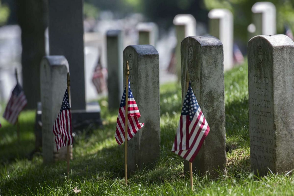American flags placed by soldiers from the 3rd US Infantry Regiment, The Old Guard, during the Flags In ceremony for Memorial Day, at Arlington National Cemetery in Arlington, Virginia, US, on May 26, 2016.