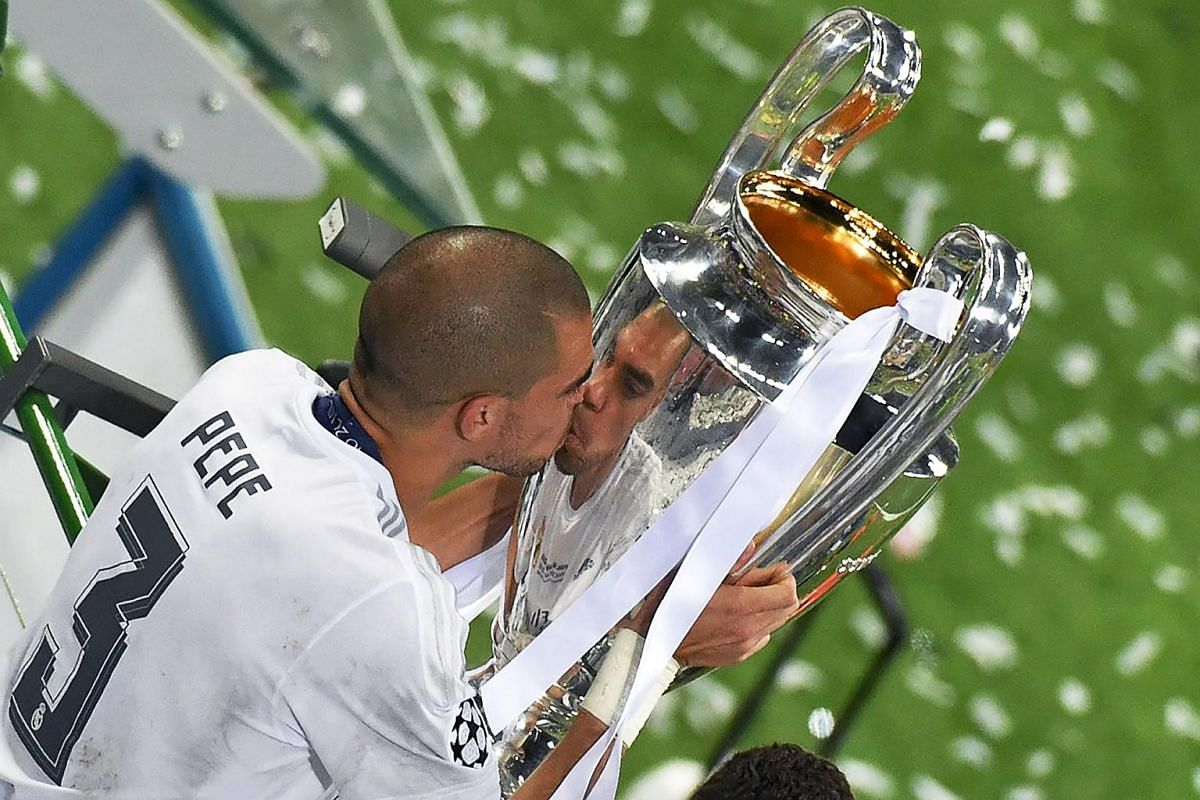 Real Madrid's Portuguese defender Pepe kisses the trophy after winning the Uefa Champions League final.