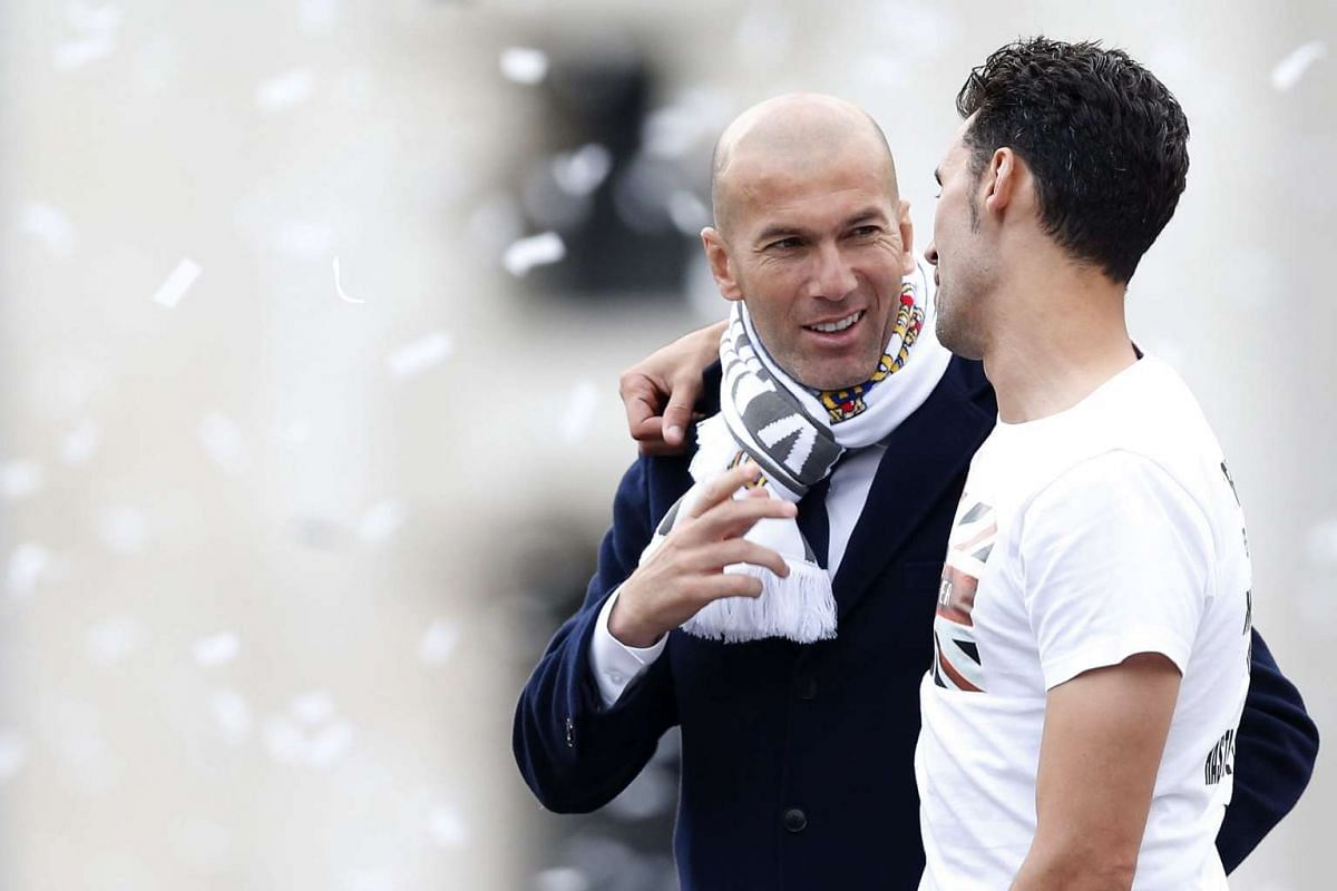 Real Madrid's head coach Zinedine Zidane (left) and Alvaro Arbeloa arrive at Cibeles Square in Madrid, Spain, May 29, 2016.