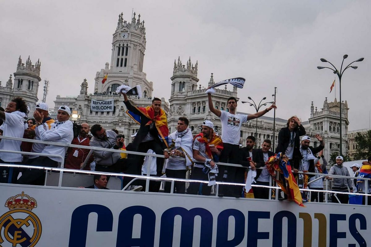 Real Madrid players celebrate from the bus the team's win on Plaza Cibeles in Madrid, on May 29, 2016.