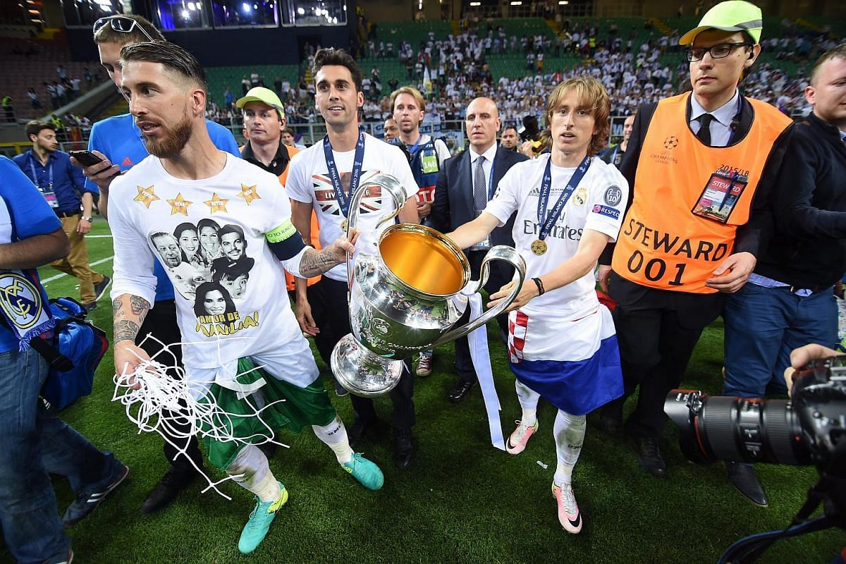 Luca Modric (right) and captain Sergio Ramos celebrate with the trophy after winning the Uefa Champions League Final.