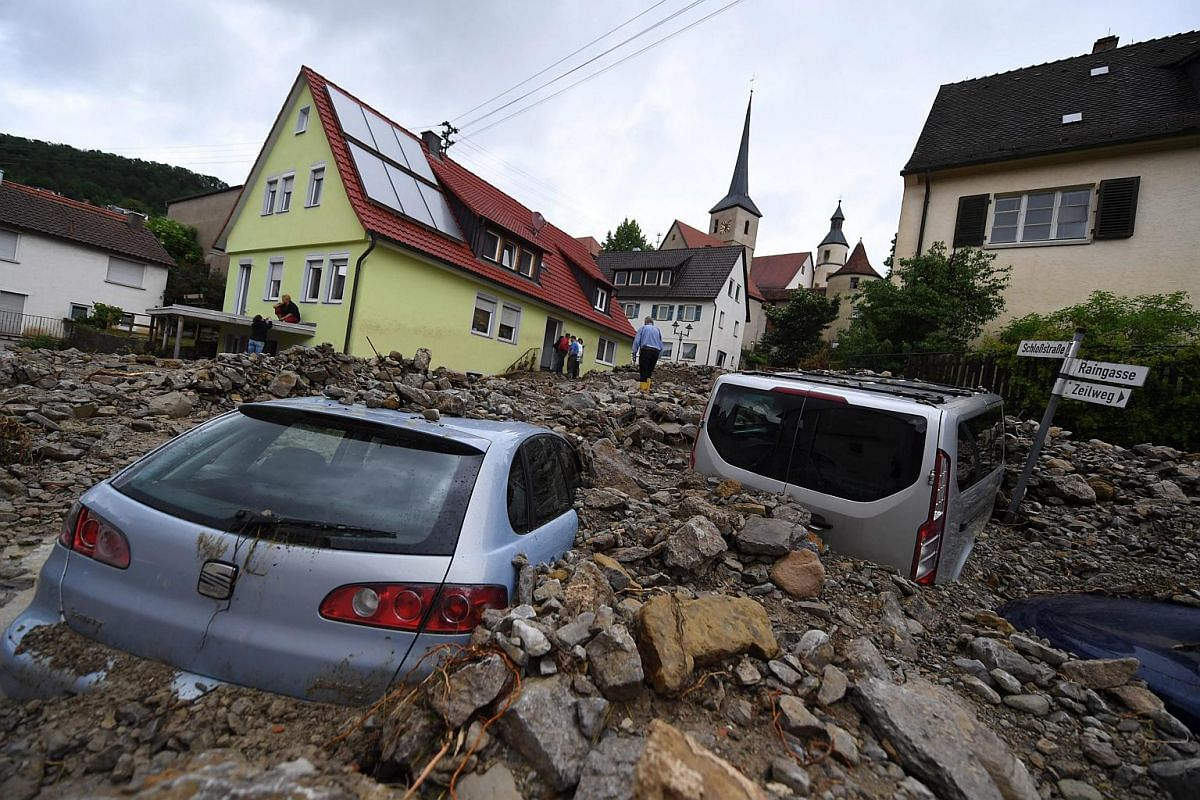 Cars are buried under debris in Braunsbach, Germany.