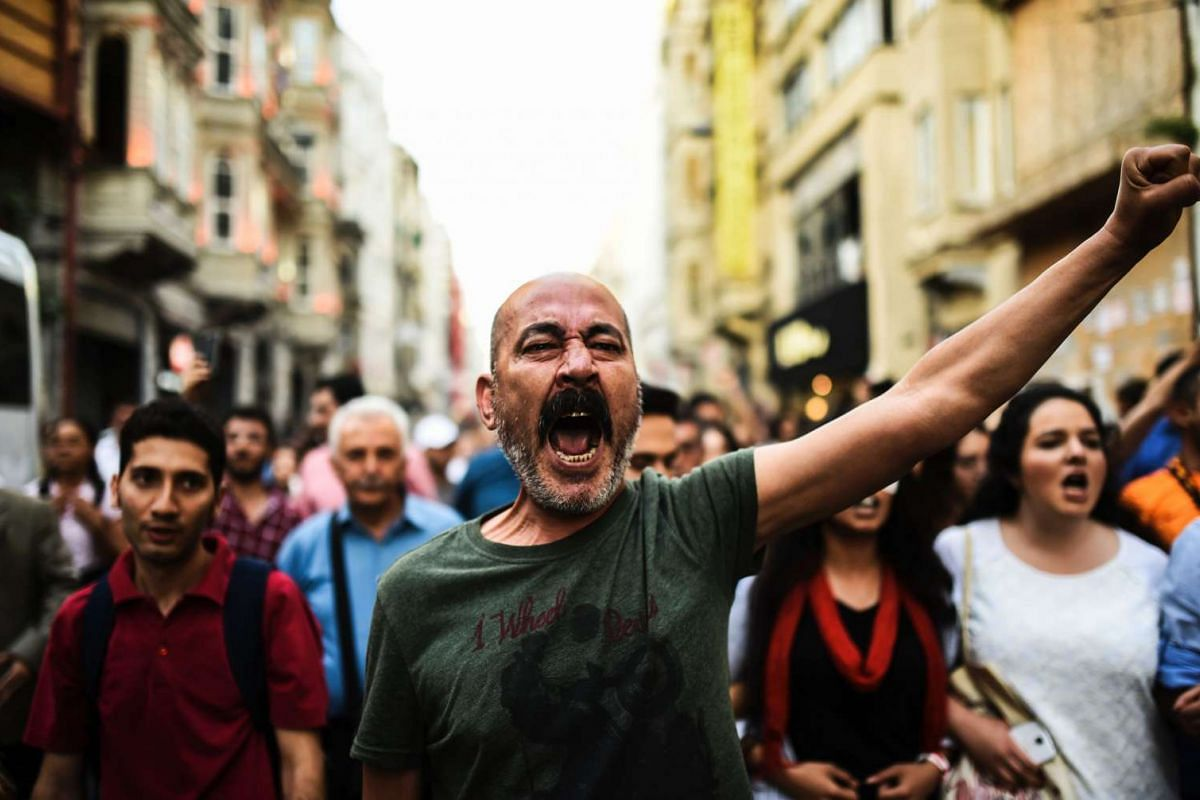 Demonstrators chant slogans on the third anniversary of the start of the Gezi Park protests in Istanbul, on May 31, 2016.