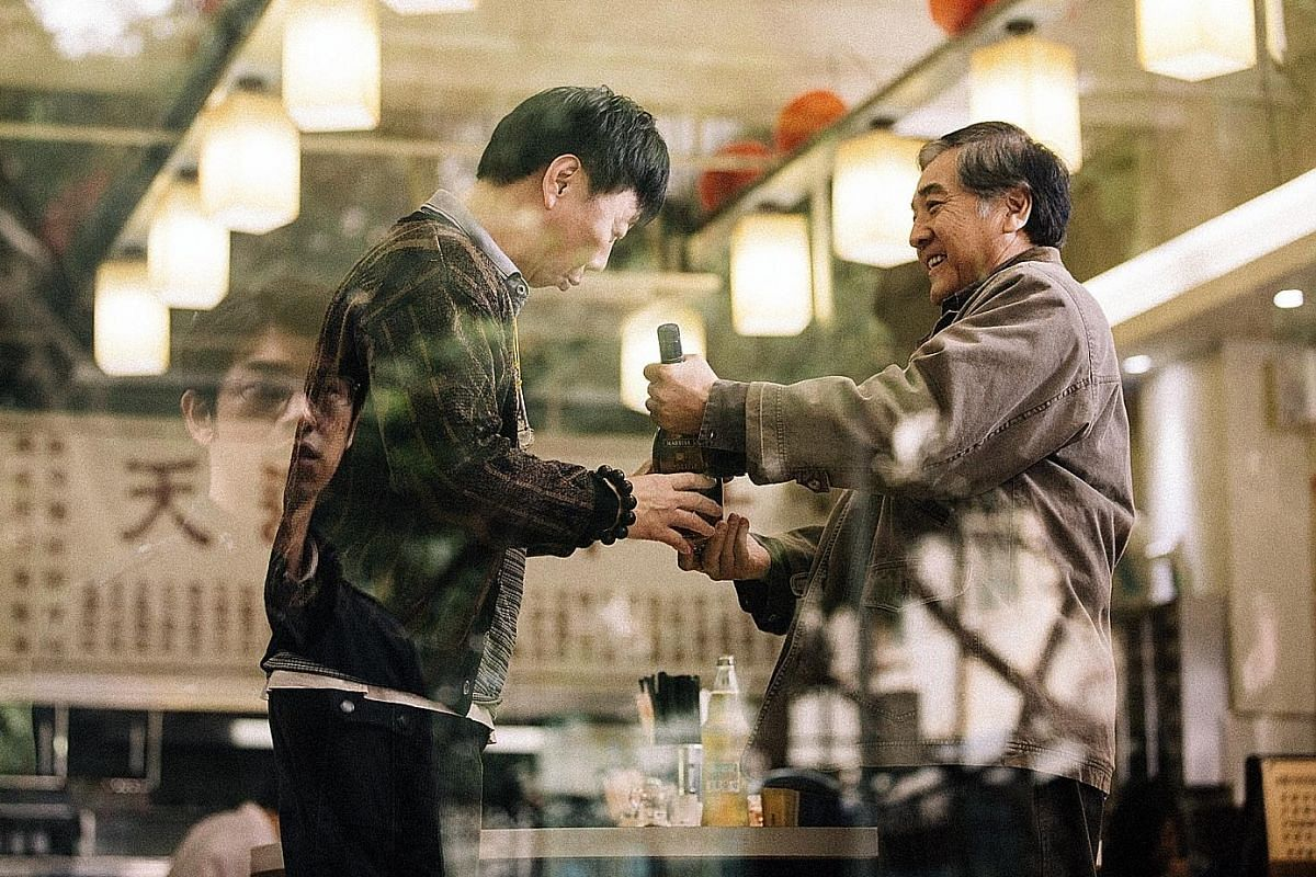 Distance comprises three stories, all featuring Chen Bo-lin (reflection). The Son, directed by China's Xin Yukun, also stars Paul Chun (right).